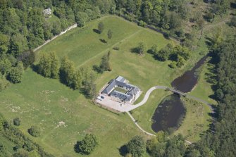 Oblique aerial view of Dougalston Factor's House, looking NE.