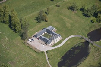 Oblique aerial view of Dougalston Factor's House, looking N.