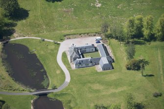 Oblique aerial view of Dougalston Factor's House, looking WSW.