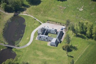 Oblique aerial view of Dougalston Factor's House, looking SW.