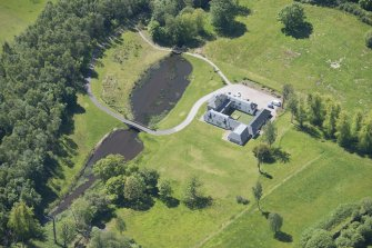 Oblique aerial view of Dougalston Factor's House, looking S.