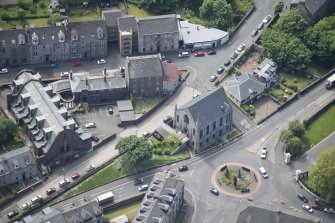 Oblique aerial view of Orangefield Baptist Church and St Patrick's Roman Catholic Church, looking SSW.
