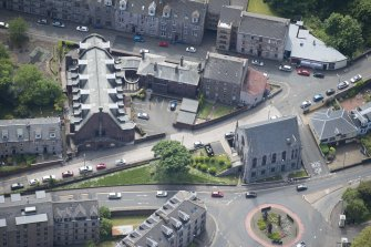 Oblique aerial view of Orangefield Baptist Church and St Patrick's Roman Catholic Church, looking S.