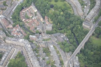Oblique aerial view of Dean Village, Damside, Dean Path, Dean Bridge, Rothesay Terrace, Belgrave Terrace, Holy Trinity Espicopal Church and Drumsheugh Baths, looking NW.