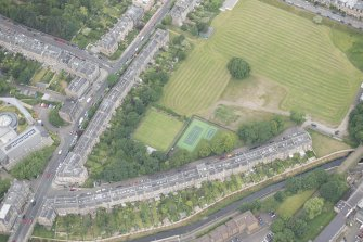 Oblique aerial view of Warriston Crescent and Inverleith Row, looking NW.