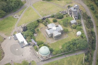Oblique aerial view of Playfair's Monument, Observatory House, City Observatory and City Dome, looking SSW.