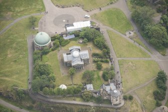 Oblique aerial view of the City Observatory, Observatory House, Playfair's Monument and City Dome, looking E.