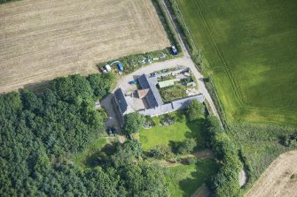 Oblique aerial view of Haddo House, steading and walled garden, looking N.