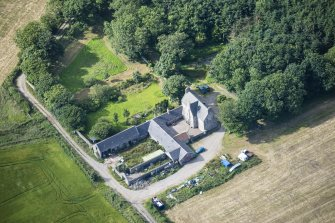Oblique aerial view of Haddo House, steading and walled garden, looking SSW.