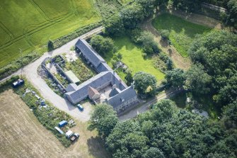 Oblique aerial view of Haddo House, steading and walled garden, looking ESE.