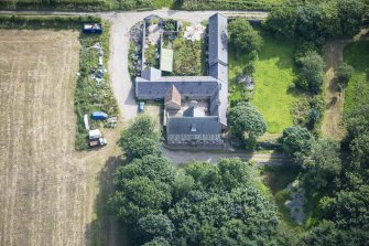 Oblique aerial view of Haddo House, steading and walled garden, looking ENE.