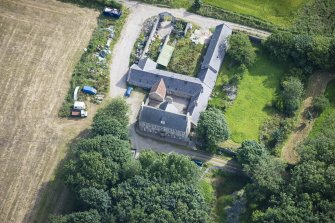 Oblique aerial view of Haddo House, steading and walled garden, looking NE.