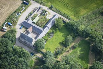 Oblique aerial view of Haddo House, steading and walled garden, looking NNE.