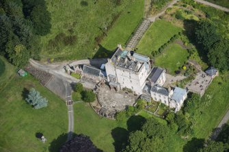 Oblique aerial view of Delgatie Castle, looking NW.