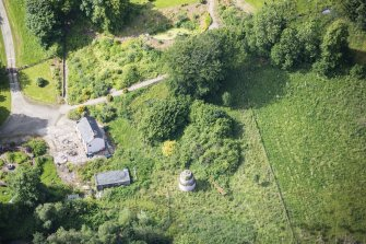 Oblique aerial view of Delgatie Castle Dovecot and Foresters Cottage, looking SSW.