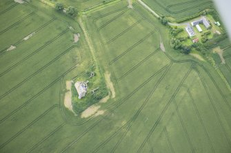 Oblique aerial view of Inchdrewer Castle and the cropmarks of the ditch, looking S.