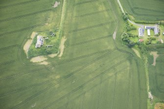Oblique aerial view of Inchdrewer Castle and the cropmarks of the ditch, looking SSE.