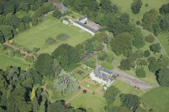Oblique aerial view of Kirknewton House, looking NW.