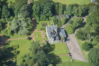 Oblique aerial view of Kirknewton House, looking WSW.