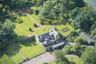 Oblique aerial view of Kirknewton House, looking S.