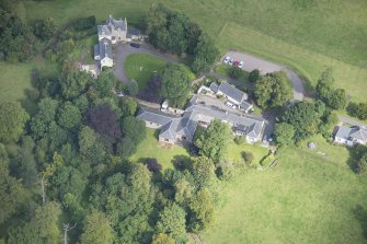 Oblique aerial view of Peel Lodge, Tower House and Stables, looking NE.
