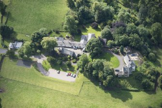 Oblique aerial view of Peel Tower House, looking SW.