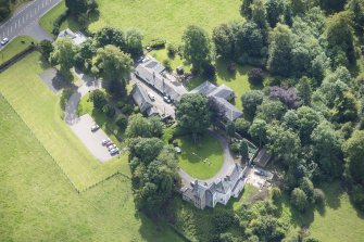 Oblique aerial view of Peel Tower House and Stables, looking SSE.