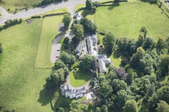 Oblique aerial view of Peel Lodge, Tower House and Stables, looking SE.