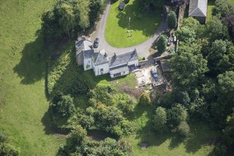 Oblique aerial view of Peel Tower House, looking ESE.