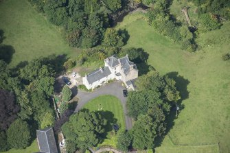 Oblique aerial view of Peel Tower House, looking NW.