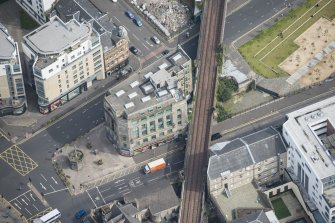 Oblique aerial view of the Mercat Building and Mercat Cross, looking NE.