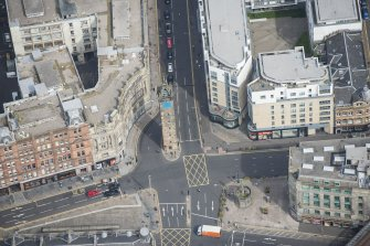 Oblique aerial view of the Trongate Tolbooth Steeple, Mercat Building and Mercat Cross, looking NNE.