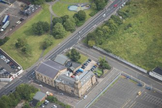Oblique aerial view of Kirkhaven Church, looking NE.