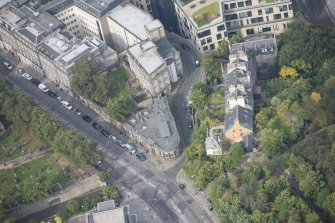 Oblique aerial view of Waterloo Place and Old Calton Burial Ground, looking NW.