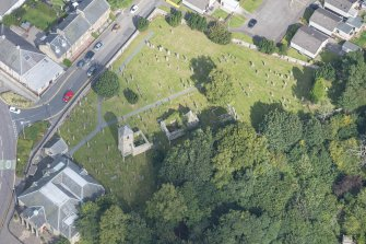 Oblique aerial view of St Kentigern's Church and Churchyard, looking NNE.