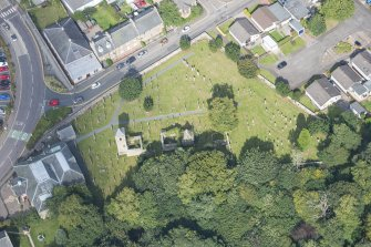 Oblique aerial view of St Kentigern's Church and Churchyard, looking N.