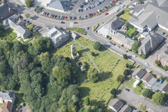 Oblique aerial view of St Kentigern's Church and Churchyard, looking NW.