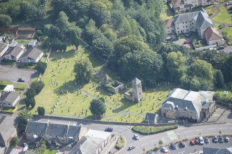 Oblique aerial view of St Kentigern's Church and Churchyard, looking SE.