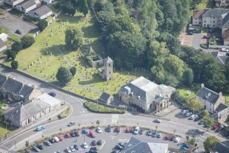 Oblique aerial view of St Kentigern's Church and Churchyard, looking ESE.