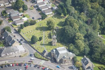 Oblique aerial view of St Kentigern's Church and Churchyard, looking E.