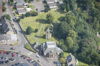 Oblique aerial view of St Kentigern's Church and Churchyard, looking ENE.