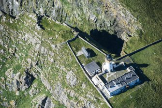 Oblique aerial view of Barra Head Lighthouse and the possible dun, looking W.