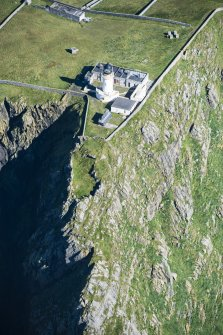 Oblique aerial view of Barra Head Lighthouse and the possible dun, looking NE.