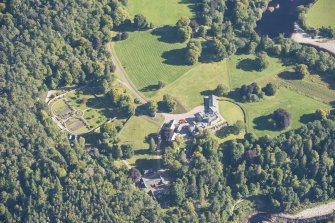 Oblique aerial view of Glenferness House and Walled Garden, looking SE.