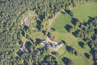 Oblique aerial view of Glenferness House and Walled Garden, looking NE.