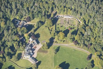Oblique aerial view of Glenferness House and Walled Garden, looking N.