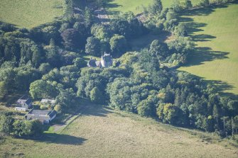 Oblique aerial view of Lickleyhead Castle, looking SSW.