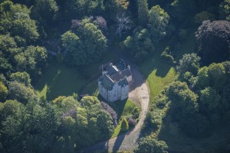 Oblique aerial view of Lickleyhead Castle, looking ESE.