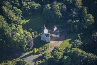 Oblique aerial view of Lickleyhead Castle, looking E.