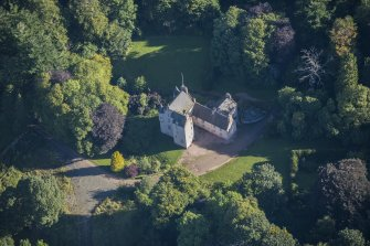 Oblique aerial view of Lickleyhead Castle, looking NE.